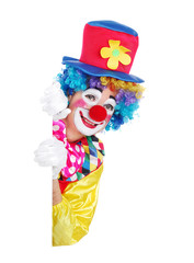 Clown in a hat and rainbow wig holding blank board isolated on white background