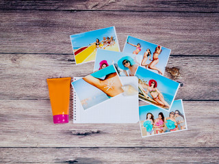 Photos of young beautiful girls in a swimsuit and sunblock on a wooden background