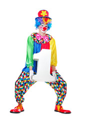 Full length picture of a standing clown in a hat and rainbow wig holding foam number one figure prop