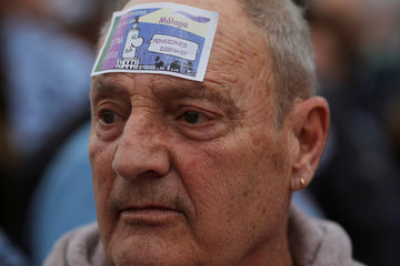 A pensioner looks on during a demonstration demanding higher state pensions, in Malaga