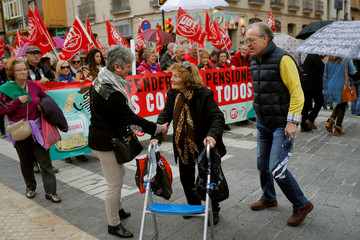 People march during a demonstration demanding higher state pensions, in Malaga