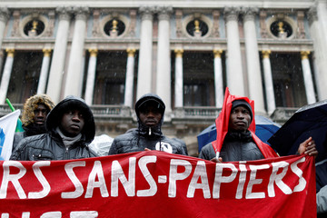 lllegal immigrant workers demonstrate to legalize their situation during a march in solidarity with migrants in Paris