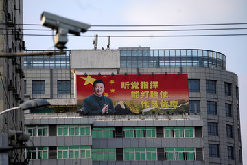 Poster with a portrait of Chinese President Xi is displayed in Shanghai