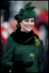 Britain's Catherine, Duchess of Cambridge holds shamrock as she attends the presentation of Shamrock to the 1st Battalion Irish Guards, at a St Patrick's Day parade at Cavalry Barracks in Hounslow