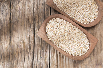 quinoa beans in bowl on rustic wooden background