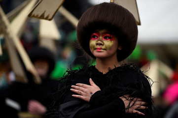 A participant is seen during the St. Patrick's Day parade in Dublin