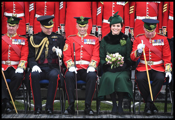 Britain's Catherine, Duchess of Cambridge and Prince Wiliam, pose for a group photograph as they attend the presentation of Shamrock to the 1st Battalion Irish Guards, at a St Patrick's Day parade at Cavalry Barracks in Hounslow, London