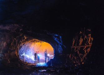 Diggers in a big cave