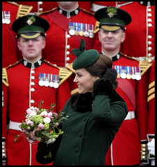Britain's Catherine, Duchess of Cambridge poses for a group photograph as she attends the presentation of Shamrock to the 1st Battalion Irish Guards, at a St Patrick's Day parade at Cavalry Barracks in Hounslow, London