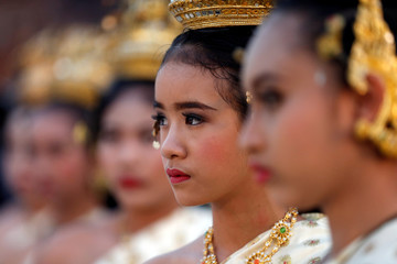 """Performers dressed as princesses attend the opening ceremony known as """"Wai Kru"""" to pay respects to Muay Thai elders in the ancient city of Ayutthaya"""