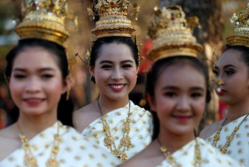 "Performers dressed as princesses attend the opening ceremony known as ""Wai Kru"" to pay respects to Muay Thai elders in the ancient city of Ayutthaya"