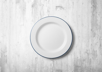 Plate with white wood background