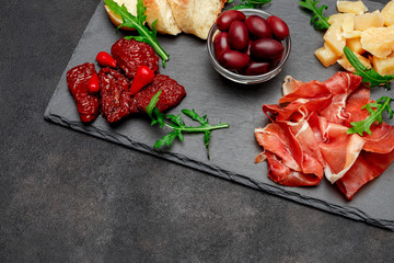 Traditional italian meals - prosciutto crudo or jamon, parmesan, tomatoes