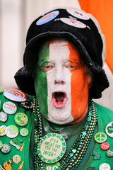 A man with his face painted with the Irish flag attends the St Patrick's Day parade in New York City