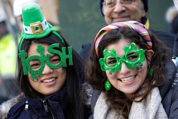 Paradegoers watch the St Patrick's Day parade in New York City