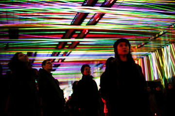 People attend 'Tunnel Visions: Array', an installation of light and sound in the Beech Street tunnel, as part of the Barbican OpenFest, in London