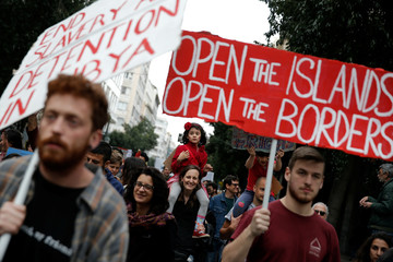 Protesters take part in a demonstration to mark United Nations day against racism in Athens