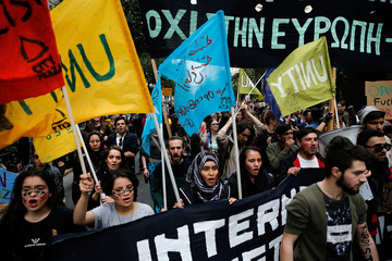 Protesters shout slogans during a demonstration to mark United Nations day against racism in Athens