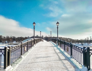 Perspective panoramic view of curved bridge at blue sky background at winter daylight time