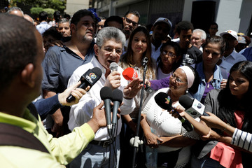 Henry Ramos Allup, lawmaker of the Venezuelan coalition of opposition parties (MUD), speaks during a gathering with opposition supporters in Caracas