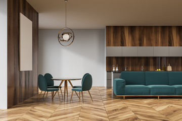 Wooden dining room, green sofa, poster
