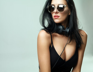 pretty sporty dark hair  girl in sunglasses listening to music