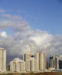 Urban high rise architecture concept. View of New Neighborhood under the blue sky