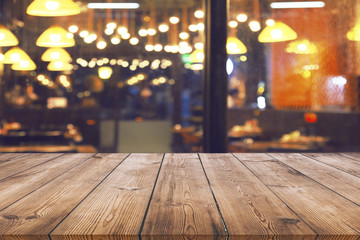 Wood table with blur light bokeh in night restaurant