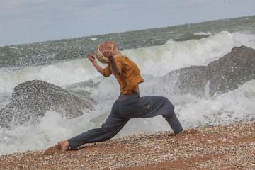 dancer on coast. waves, water