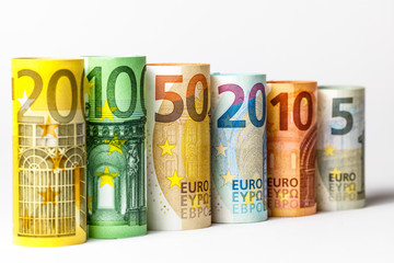 Several hundred euro banknotes stacked by value.Rolls Euro bankn
