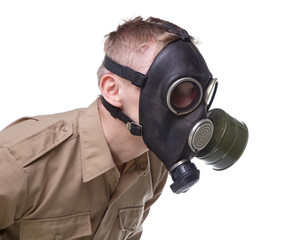 Soldier in gas mask leaned forward