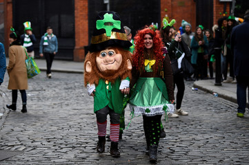 People dressed as leprechauns are seen on St. Patrick's Day in Dublin