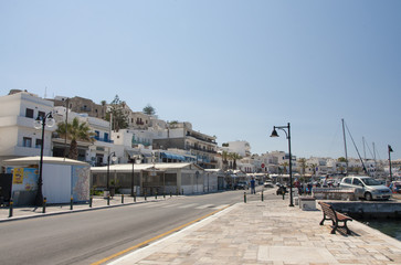 Street in the port with a view of the Naxos town at Naxos island in Greece