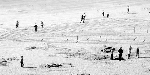 People Drawing a Maze on the Beach