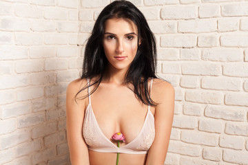 bdb1bb0190 dark hair pretty model girl looking at the camera with flower