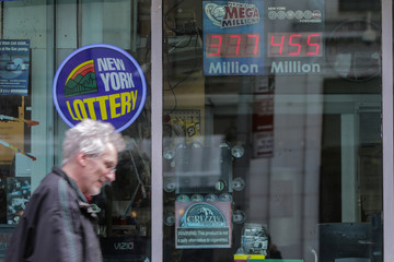 Powerball prize displays at a gas station in New York City