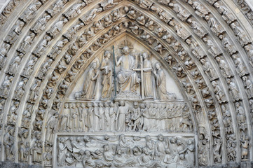 Detail of the facade of Notre Dame cathedral. France. Paris. Architecture of France.