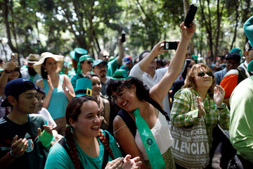 Women smile during the St Patrick's Day parade in Mexico City