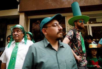People take part in the St Patrick's Day parade in Mexico City