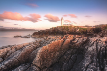 Fanad Head (Fánaid) lighthouse, County Donegal, Ulster region, Ireland, Europe. Pink sunset at Fanad Head