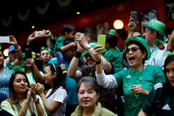 People take part during the St Patrick's Day parade in Mexico City