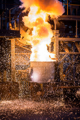 pouring steel into the converting furnace