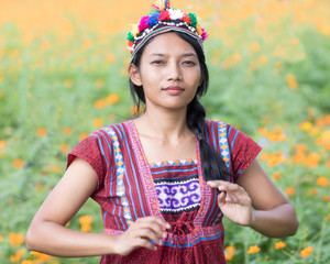 Asian woman in traditional costume for Karen on meadow
