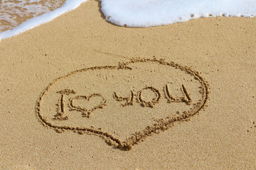 The writing on sand, I love you. Oceanic foam.