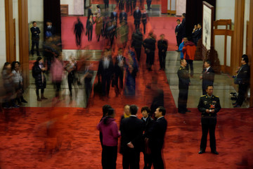 Delegates arrive for the sixth plenary session of the National People's Congress at the Great Hall of the People in Beijing