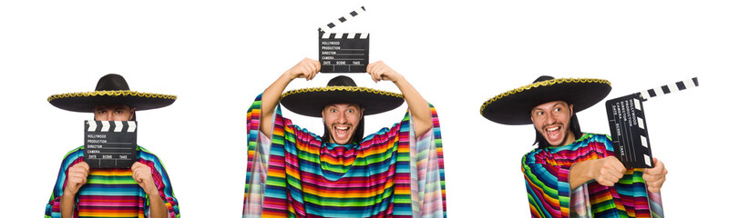 Handsome man in vivid poncho holding clapperboard isolated on wh