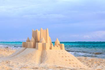 sand castle on a tropical beach near the ocean