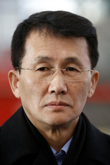 North Korean diplomat Choe Kang Il waits at Capital International Airport to check in to a flight to Helsinki in Beijing