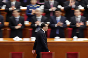 Chinese Premier Li Keqiang attends the sixth plenary session of the NPC at the Great Hall of the People in Beijing