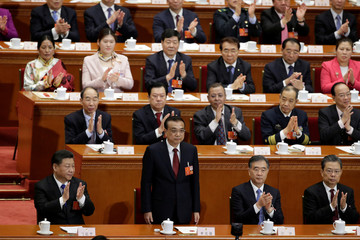 Chinese Premier Li Keqiang receives applause after he is voted as the premier for another term, at the sixth plenary session of the NPC at the Great Hall of the People in Beijing